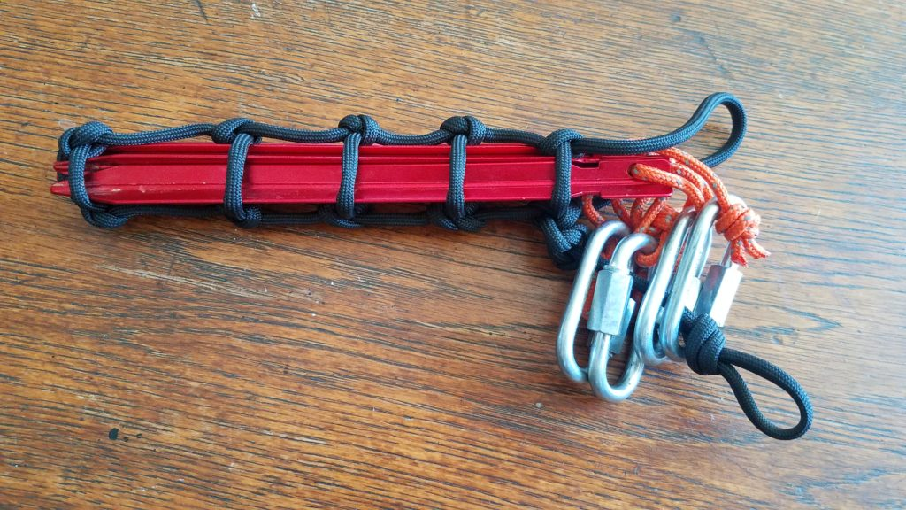 Detailed view of tent stakes secured in a paracord sleeve.